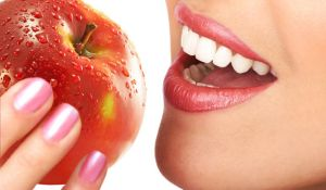 woman-with-white-straight-teeth-biting-into-apple_article_new